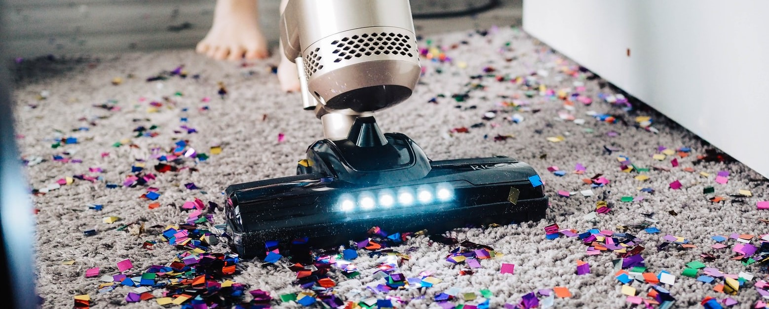 Image of vacuum vacuuming glitter